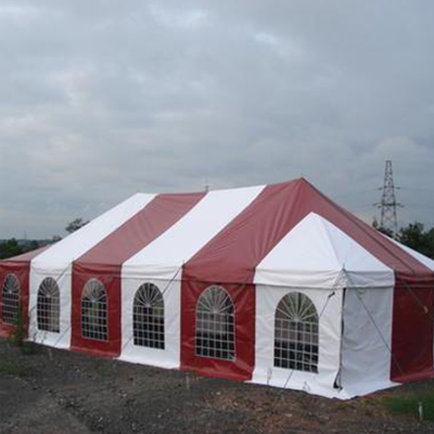 red and white peg and pole tents